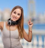 Woman dancing with headphones — Stockfoto