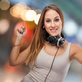 Woman dancing with headphones — Stock Photo