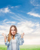 Woman doing indecision gesture — Stock Photo