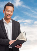 Asian man holding book — Foto Stock