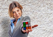 Business woman holding rubik cube — Stock Photo