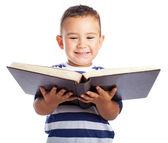 Kid holding book — Stockfoto