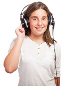 Girl using headphones — Stockfoto