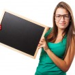 Student holding chalkboard — Stock Photo #47379803
