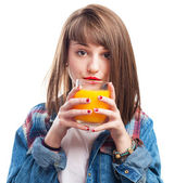 Young woman holding orange juice — Stock Photo