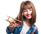 Woman playing with airplane — Stock Photo