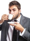 Businessman drinking coffee — Stock Photo