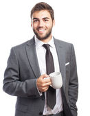 Business man holding tea mug — Stock Photo