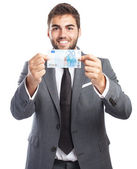 Businessman holding euro banknote — Stock Photo