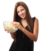 Woman with popcorn — Stock Photo