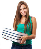 Teenager holding books stack — Stock Photo