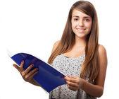 Girl holding notebook — Stock Photo