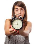 Mujer holding despertador — Foto de Stock