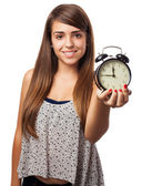 Young woman holding alarm clock — Photo