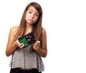 Girl holding broken hard drive — ストック写真