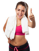 Sporty woman with thumb up — Stockfoto