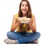 Woman holding pop corn bowl — Stock Photo #47424143