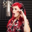 Young woman recording song — Stock Photo