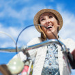 Woman bicycling at park — Stock Photo #47429129