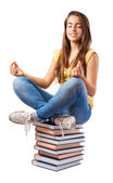 Girl sitting on books tower — Stock Photo