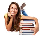 Woman hugging books — Stockfoto