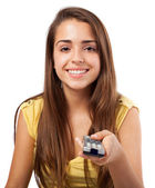 Woman holding tv control — Stock Photo