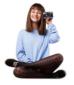 Young girl holding photo camera — Stock Photo