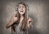 Young woman with headphones — Stock Photo