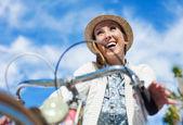 Woman bicycling at park — Stock Photo