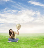 Woman holding world globe — Stock Photo