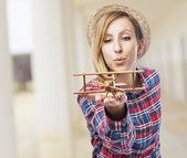 Woman with plane — Stockfoto