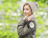 Woman holding clock — Stock Photo
