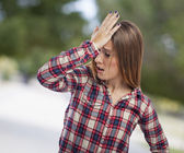 Woman with worried gesture — Stock Photo