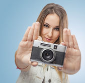 Woman showing camera — Stock fotografie