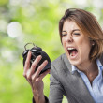 Woman screaming to clock — Stock Photo #47456607
