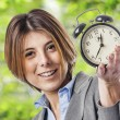 Business woman with clock — Stock Photo #47456531