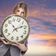 Business woman holding clock — Stock Photo #47456685