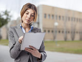 Woman with headphones and tablet — Stock Photo