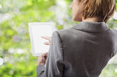 Businesswoman using tablet — Stock Photo