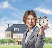 Business woman with clock — Stock Photo