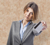 Woman using credit card — Stock Photo
