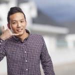 Man doing call gesture — Stock Photo #47461995