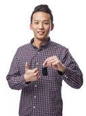 Man holding car key — Stock Photo
