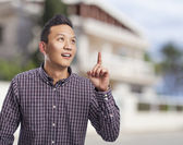 Man pointing up finger — Stock Photo