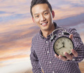 Man holding clock — Photo