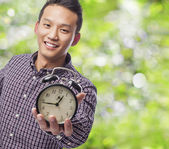 Man holding clock — Stock Photo