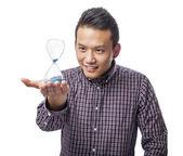Man holding sand timer — Stock Photo
