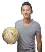 Man holding globe — Stock Photo