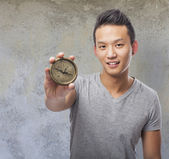 Man holding compass — Stock Photo