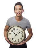 Man holding clock — Stok fotoğraf